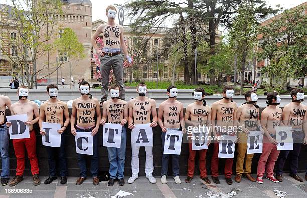Bare chested men, members of the anti-gay marriage group Hommen, demonstrate in Toulouse on April 18, 2013. French Prime Minister Jean-Marc Ayrault...