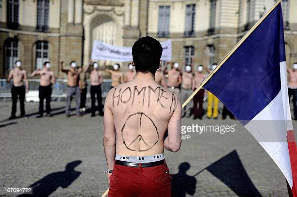 Bare chested men, members of the anti-gay marriage group Hommen, demonstrate on April 20, 2013 in Rennes, western France. The final vote on France's...