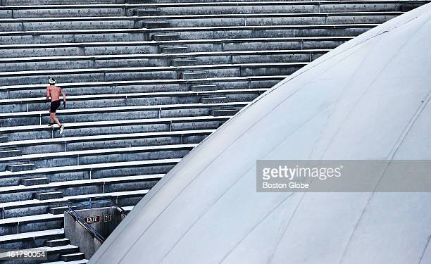 Bare chested runner foregoes the warmth of the Bubble placed in Harvard Stadium to run the icy stairs.
