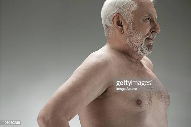 bare chested senior man - senioren aktfotos stock-fotos und bilder