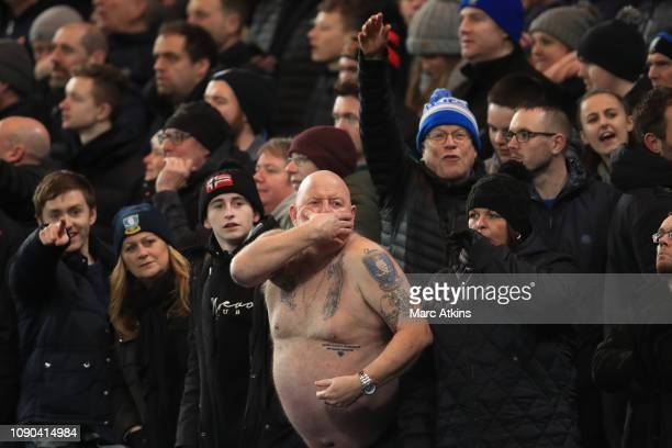 A bare chested Sheffield Wednesday fan gestures during the FA Cup Fourth Round match between Chelsea and Sheffield Wednesday at Stamford Bridge on...
