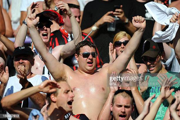 A bare chested soccer fan reacts after being hosed during the German DFB cup football match FC Erzgebirge Aue vs Eintracht Frankfurt on August 19...