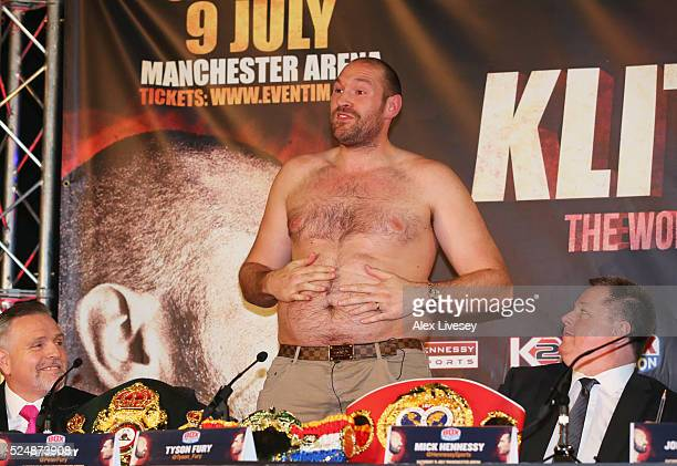 Bare chested WBO, WBA and IBO heavyweight champion Tyson Fury speaks after removing his shirt during Tyson Fury and Wladimir Klitschko head to head...
