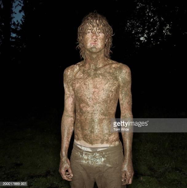 A Naked Man Crawling Through The Mud Stock Photo 38187787