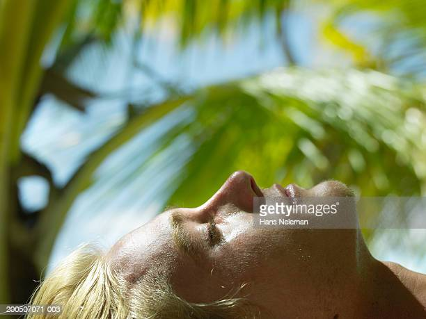 bare chested young man lying in shade, profile, close-up - chest barechested bare chested stock-fotos und bilder