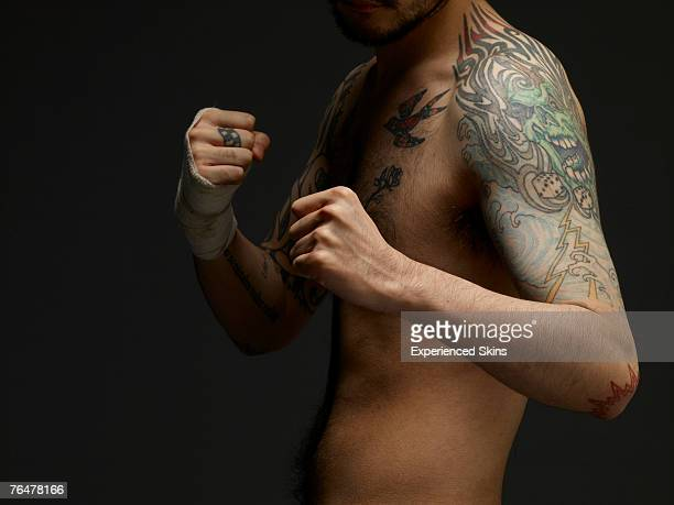 bare chested young man with tattoos, ready to box - chest barechested bare chested fotografías e imágenes de stock