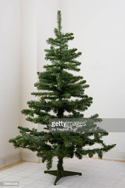 bare christmas tree - artificial stock pictures, royalty-free photos & images