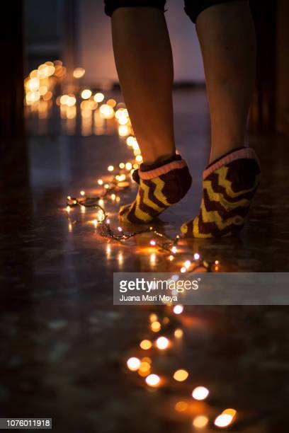 bare feet follow a path of lights - stockings no shoes stock pictures, royalty-free photos & images