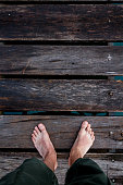 http://www.istockphoto.com/photo/bare-feet-on-a-wooden-floor-gm824935894-133750309