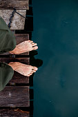 http://www.istockphoto.com/photo/bare-feet-on-the-edge-of-the-board-bottom-water-gm824935758-133750307