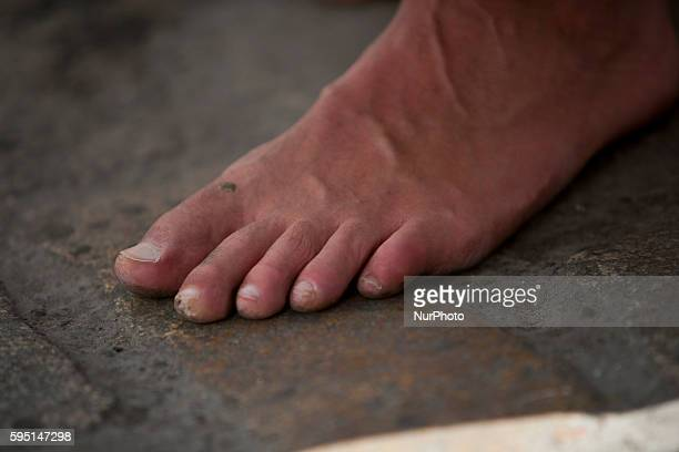 Bare foot of a quotnazarenoquot of the Brotherhood called quotLa Pazquot during its parade to Cathedral on Sunday of Palms day called Domingo de...