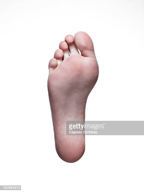 Bare foot on white background