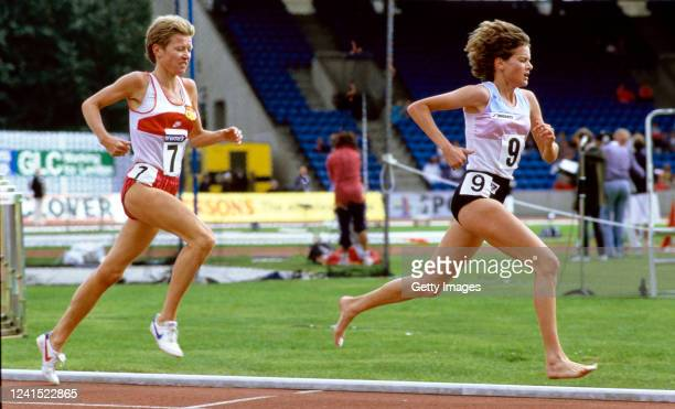 Bare footed athlete Zola Budd leads Ingrid Kristiansen of Norway on her way to breaking the Women's 5000 metre World Record at Crystal Palace on...