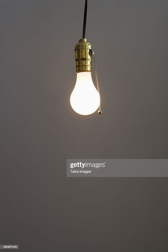 bare light bulb hanging from ceiling stock photo getty images