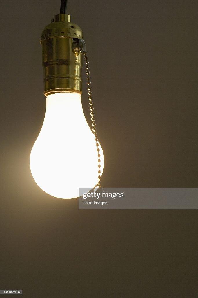 Bare light bulb hanging from ceiling stock photo getty images bare light bulb hanging from ceiling stock photo aloadofball Gallery