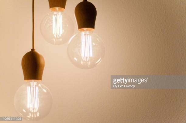 bare lightbulbs - electric lamp stock pictures, royalty-free photos & images