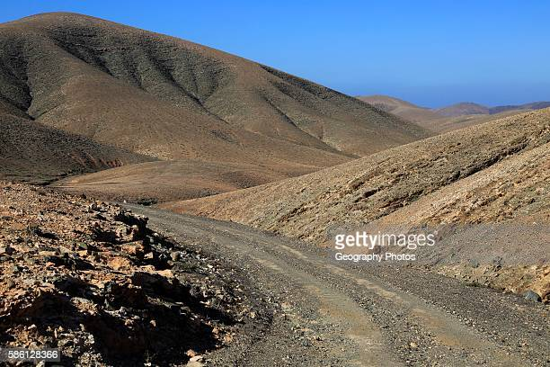 Bare moonlike arid landscape in mountains between Pajara and La Pared Fuerteventura Canary Islands Spain