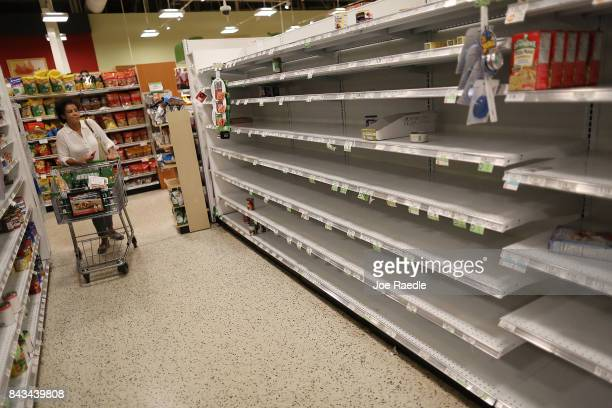 Bare shelves are seen after the supply of bottled water was emptied at a grocery store by people preparing for Hurricane Irma on September 6 2017 in...