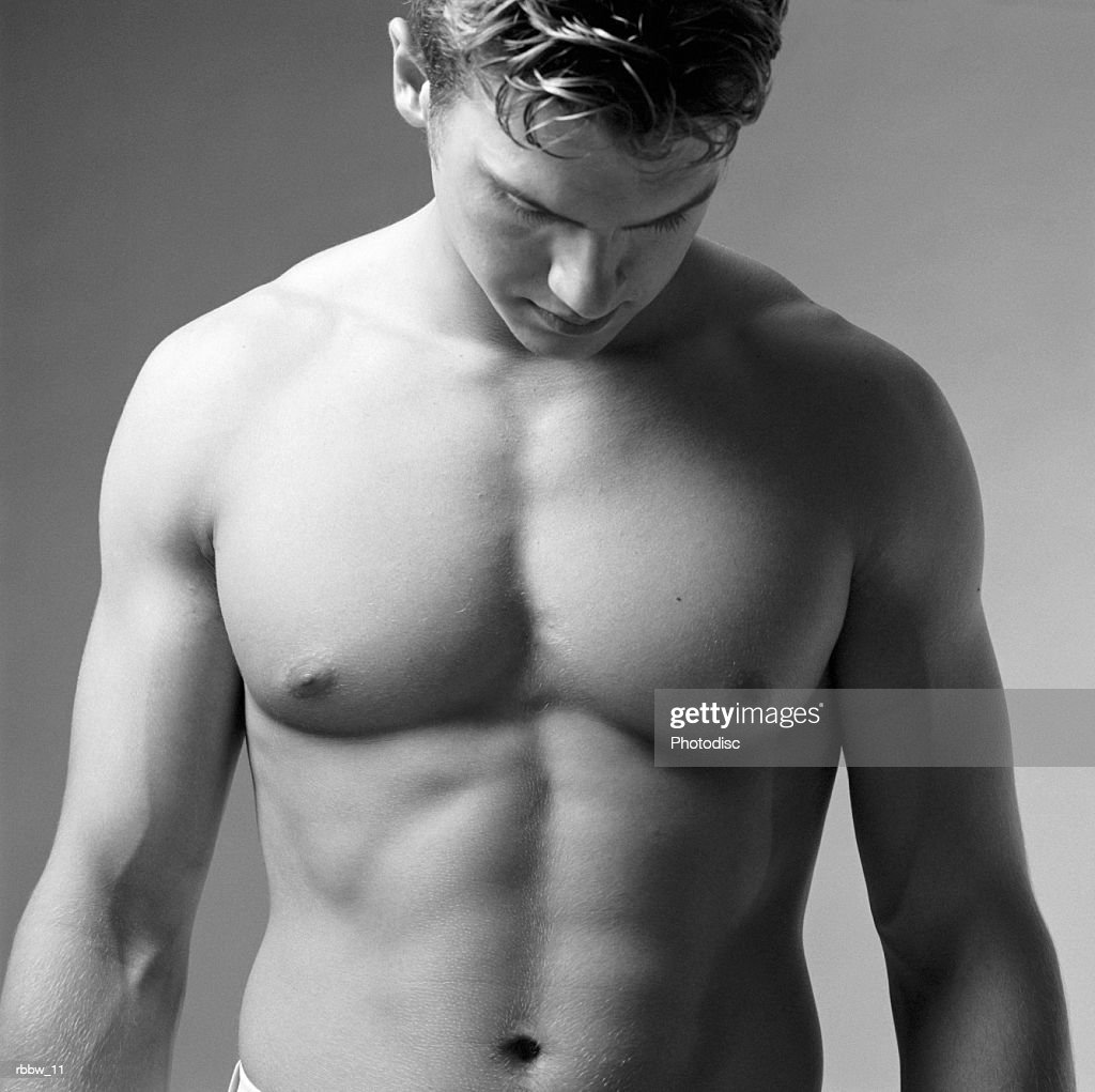 A bare torso of a muscular caucasian male : Stock Photo