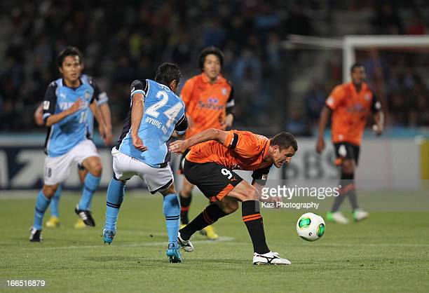 Bare whose real name is Jader Volnei Spindler of Shimizu SPulse and Cho Byung kuk of Jubilo Iwata compete for the ball during the JLeague match...