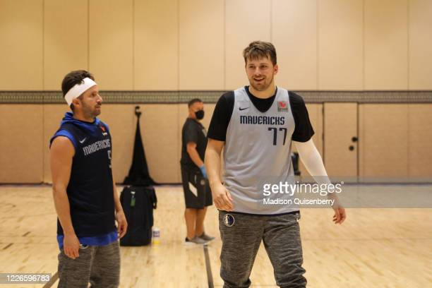 Barea and Luka Doncic of the Dallas Mavericks talk during practice as part of the NBA Restart 2020 on July 12, 2020 in Orlando, Florida. NOTE TO...