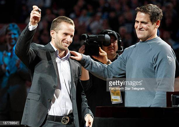 J J Barea left shows off his Dallas Mavericks NBA championship ring as owner Mark Cuban looks on before the team plays host to the Minnesota...