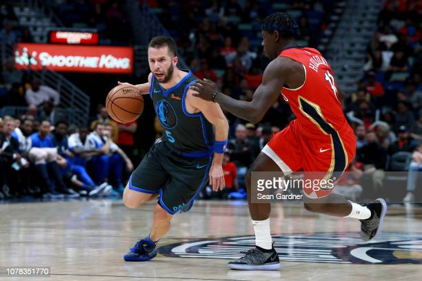 J Barea of the Dallas Mavericks dribbles the ball past Jrue Holiday of the New Orleans Pelicans during a NBA game at the Smoothie King Center on...