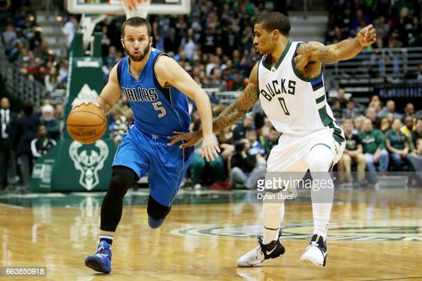 J Barea of the Dallas Mavericks dribbles the ball while being guarded by Gary Payton II of the Milwaukee Bucks in the third quarter at BMO Harris...