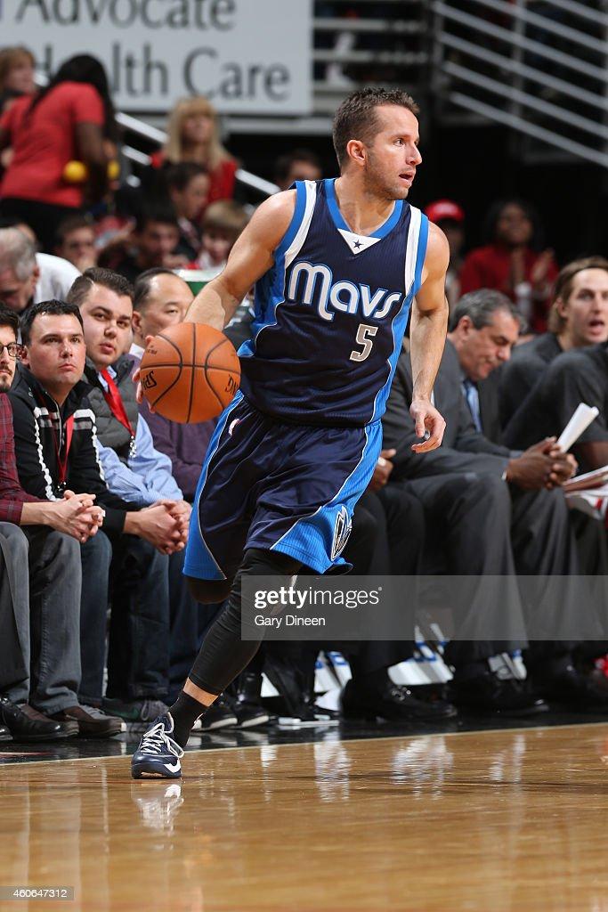 J J  Barea of the Dallas Mavericks drives against the