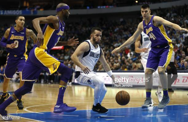 J Barea of the Dallas Mavericks drives inside as Kyle Kuzma Corey Brewer and Ivica Zubac of the Los Angeles Lakers look on in the second half at...