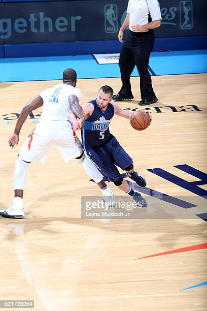 J Barea of the Dallas Mavericks handles the ball against Serge Ibaka of the Oklahoma City Thunder in Game One of the Western Conference Quarterfinals...