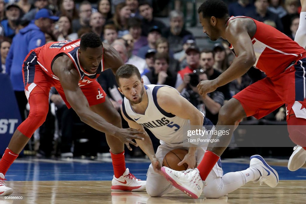 J.J. Barea #5 of the Dallas Mavericks scrambles for the ball against Ian Mahinmi #28 of the Washington Wizards and John Wall #2 of the Washington Wizards in the first half at American Airlines Center on January 22, 2018 in Dallas, Texas.