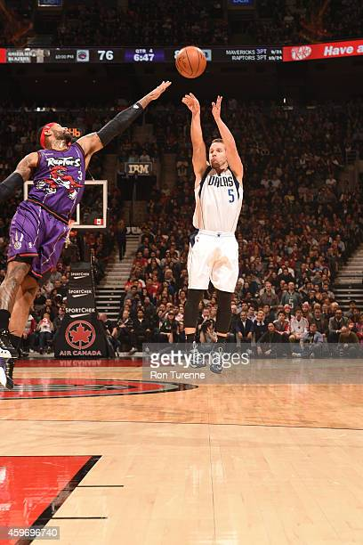 J Barea of the Dallas Mavericks shoots the ball against the Toronto Raptors during the game on November 28 2014 at the Air Canada Centre in Toronto...