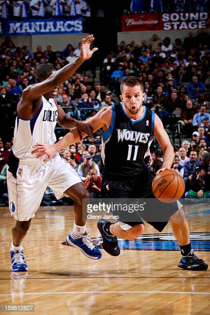 J Barea of the Minnesota Timberwolves drives against Darren Collison of the Dallas Mavericks on January 14 2013 at the American Airlines Center in...