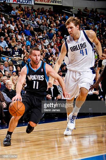 J Barea of the Minnesota Timberwolves drives against Dirk Nowitzki of the Dallas Mavericks on January 14 2013 at the American Airlines Center in...