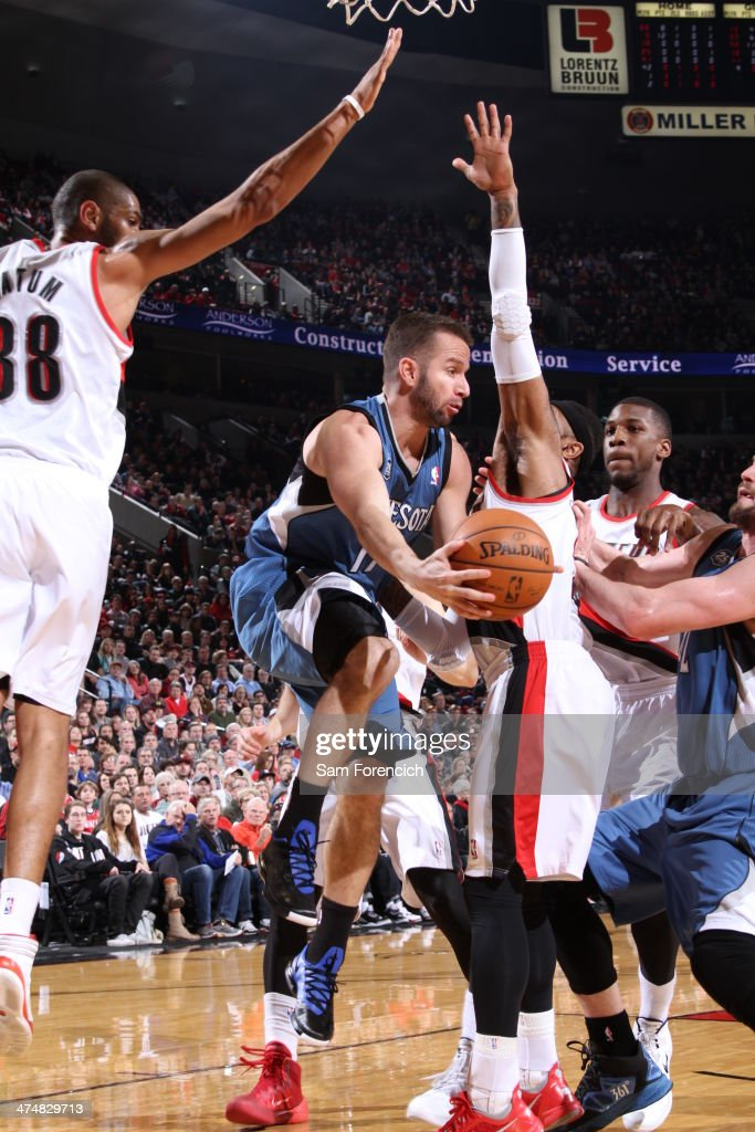 J.J. Barea #11 of the Minnesota Timberwolves drives to the basket and passes the ball against the Portland Trail Blazers on February 23, 2014 at the Moda Center Arena in Portland, Oregon.
