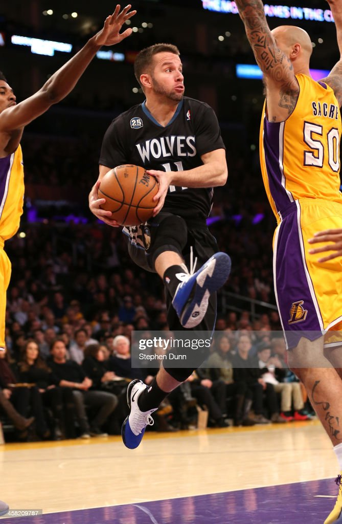 J.J. Barea #11 of the Minnesota Timberwolves looks to pass as he jumps in the lane against the Los Angeles Lakers at Staples Center on December 20, 2013 in Los Angeles, California.
