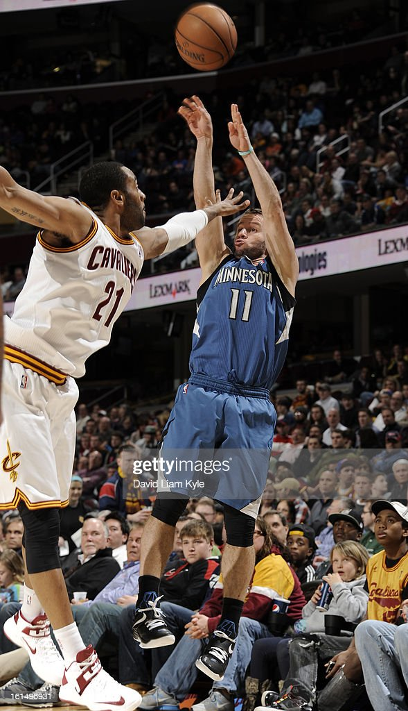 J.J. Barea #11 of the Minnesota Timberwolves shoots over Wayne Ellington #21 of the Cleveland Cavaliers at The Quicken Loans Arena on February 11, 2013 in Cleveland, Ohio.