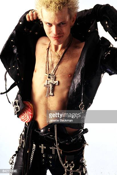 A barechested Billy Idol adjusts his leather jacket and proffers the usual rock star smirk 1985 New York City