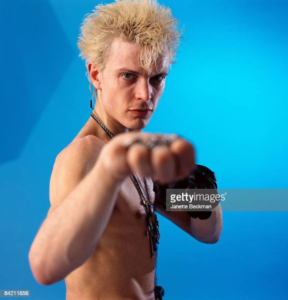 A barechested Billy Idol shadow boxes for the camera 1985 New York City