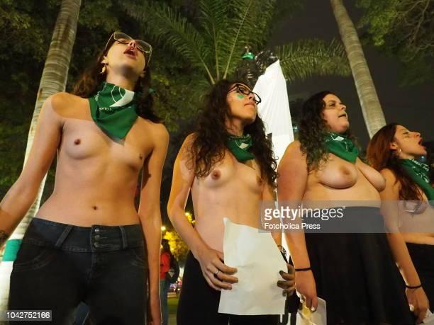 Barechested girls demanding the legalization of abortion when dozens of women wearing green handkerchiefs took to the streets of Lima demanding the...
