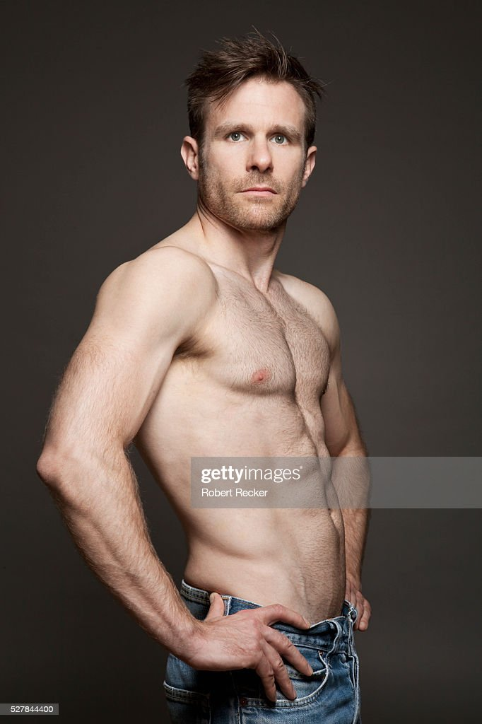 Bare-chested good-looking man : Stock Photo