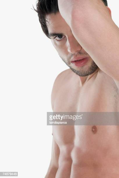 bare-chested hispanic man holding arm up - chest barechested bare chested fotografías e imágenes de stock