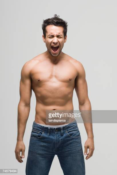 bare-chested hispanic man yelling - chest barechested bare chested stock-fotos und bilder