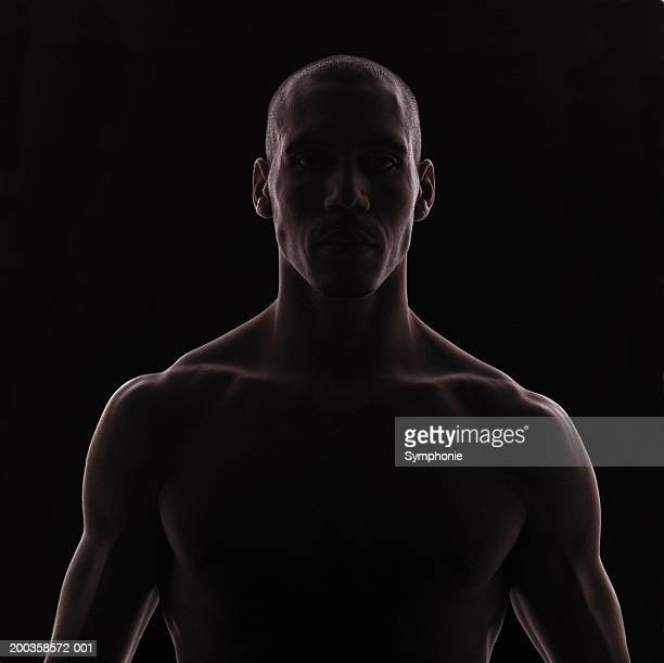 bare-chested man, backlit - chest barechested bare chested stock-fotos und bilder
