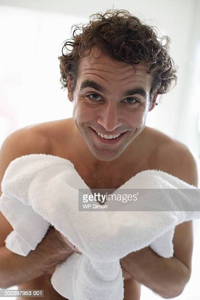 bare-chested man holding towel, smiling, portrait, close-up - barechested bare chested ストックフォトと画像