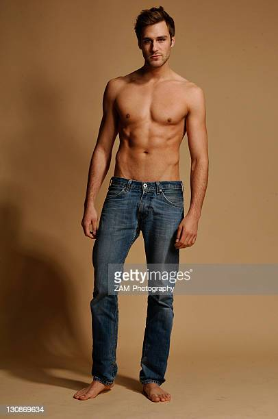 Bare-chested man in jeans