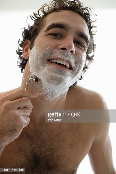 bare-chested man shaving, portrait, close-up - barechested bare chested ストックフォトと画像