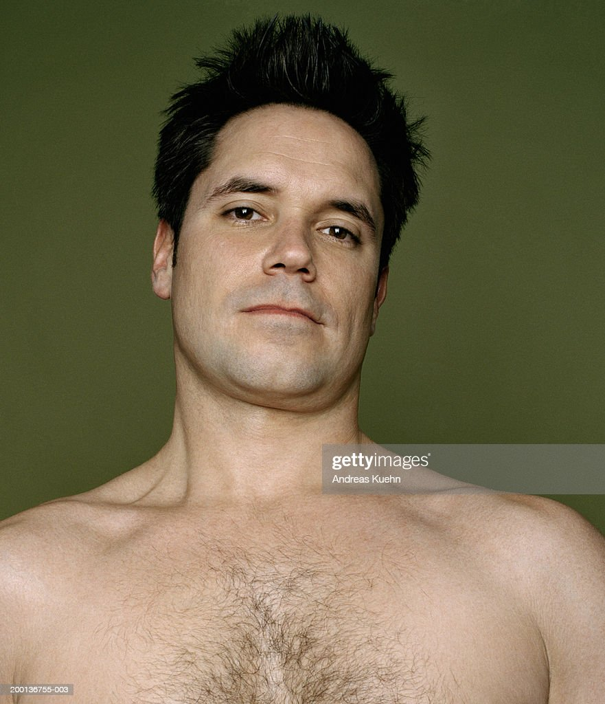 bare-chested man smiling, portrait : Stock Photo