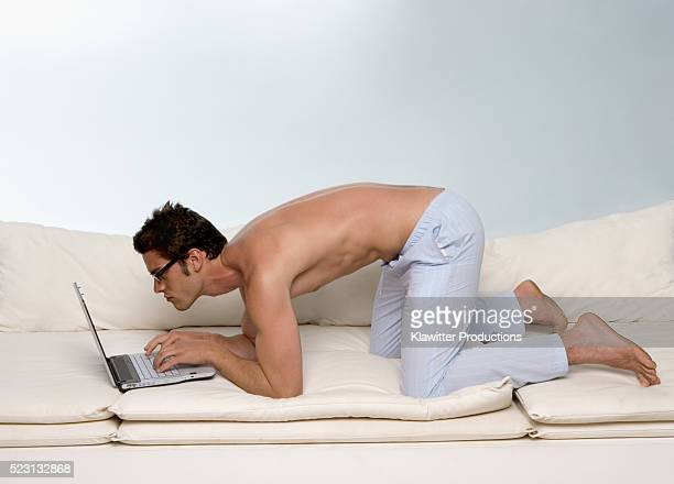 Barechested Man Using Laptop
